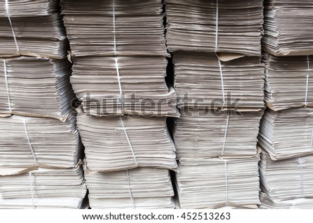 rows of piled up bundles of newspapers - stock photo