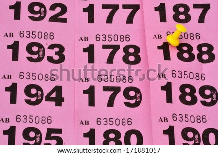 rows of raffle tickets with winner highlighted - stock photo
