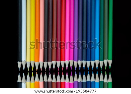 rows of rainbow colored pencils - stock photo