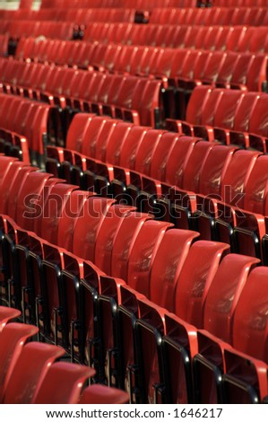 Rows of red seats at Old Trafford, the Theatre of Dreams - stock photo