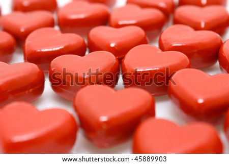 Rows of red wooden hearts - closeup view - stock photo