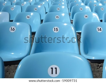 Rows of seats at stadium.        Convenient sitting for all. - stock photo
