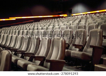 rows of seats in a cinema hall - stock photo