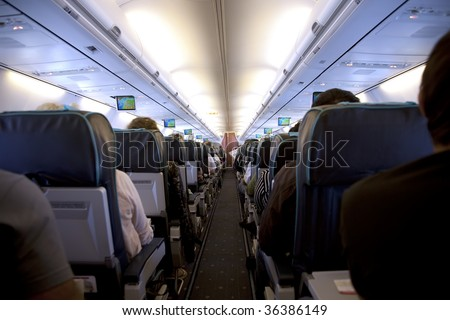 rows of seats in airplane - stock photo