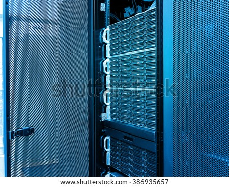rows of server hardware in the data center - stock photo