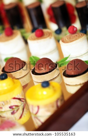 rows of tasty looking desserts in beautiful arrangements - stock photo