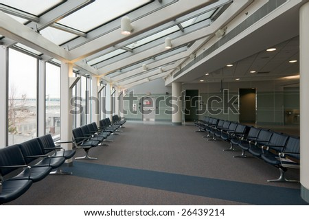 Rows of vacant chairs at empty airport waiting area - stock photo