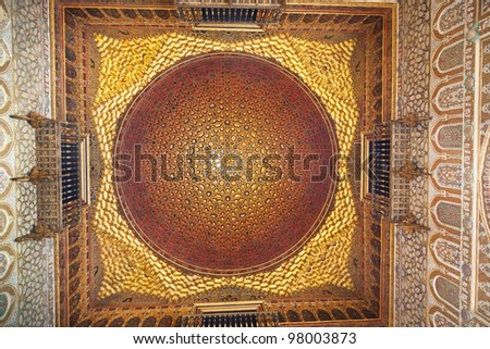Royal Alcazar of Sevilla. Amazing wooden and golden vault in the mudejar palace - stock photo