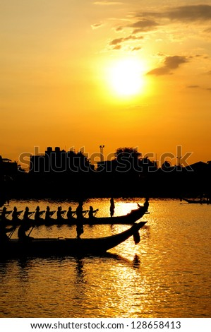 Royal Barge Procession at the Chao Phraya River in Bangkok, Thailand during sunset time - stock photo
