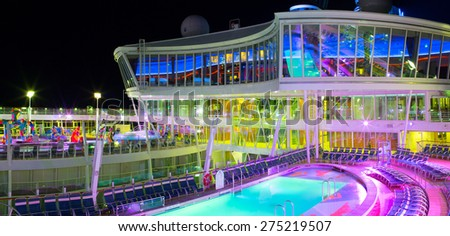 """ROYAL CARIBBEAN """"OASIS OF THE SEAS"""" - MARCH 4, 2013: Open pool deck of the luxury cruise ship. Over 5,500 guests are cruising every week. - stock photo"""