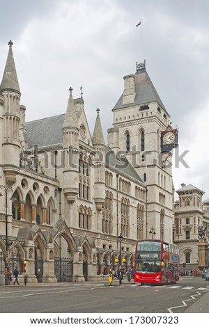 Royal Courts of Justice and red double decker in London, England - stock photo