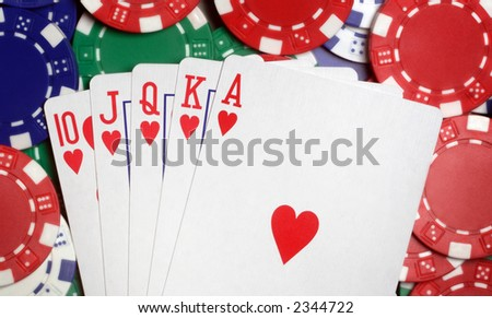 Royal flush and casino chips - stock photo