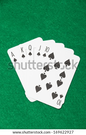 royal flush combination at poker on the green casino table - stock photo