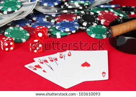 royal flush on a red poker table close-up - stock photo