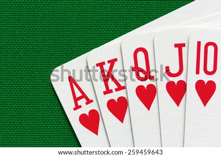 Royal flush over green textile background. Close-up view. - stock photo