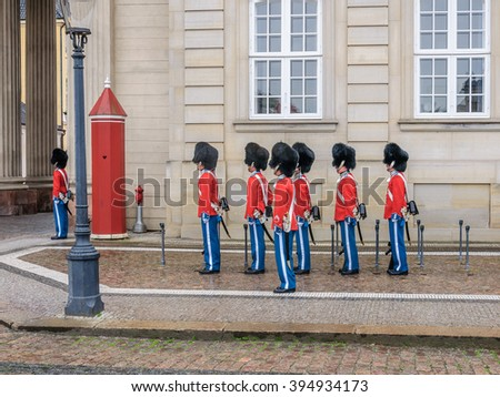Royal Guards during the ceremony of changing the guards on the square at Amalienborg Castle, Copenhagen, Denmark - stock photo