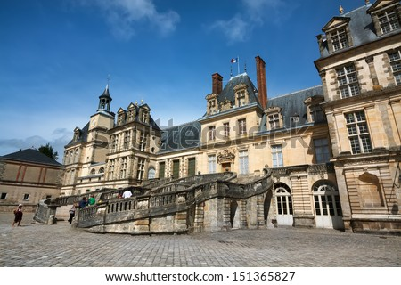 Royal hunting castle Fontainbleau. Palace of Fontainebleau - one of largest royal chateaux in France (55 km from Paris), UNESCO World Heritage Site. - stock photo