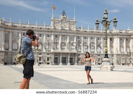 Royal Palace Madrid. Tourists taking pictures by the Palacio de Oriente - the Royal Palace of Madrid. - stock photo