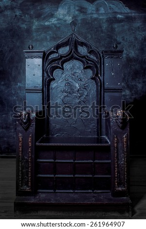 Royal throne. dark Gothic throne, front view - stock photo