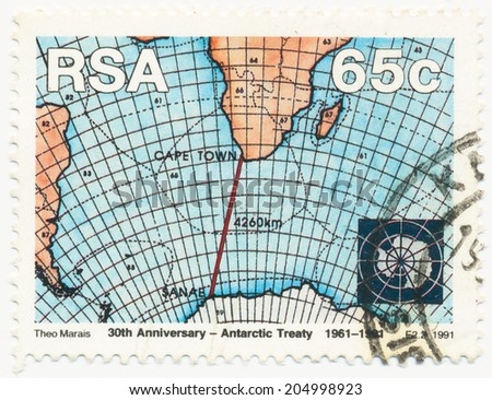 RSA - CIRCA 1991: A stamp printed in RSA shows Map of the Southern Ocean and the red line connecting Cape Town and Sanae in Antarctic, circa 1991 - stock photo