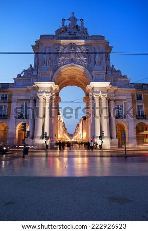 Rua Augusta Arch at night in Lisbon, Portugal. View from the Commerce Square (Portuguese: Praca do Comercio, Terreiro do Paco). - stock photo