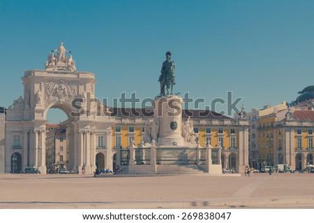 Rua Augusta Arch  on Commerce Square, Lisbon, Portugal, retro toned - stock photo