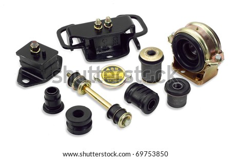 Rubber auto parts and necessary auto gears isolated on white - stock photo