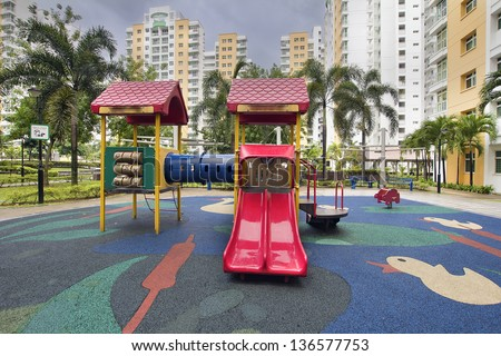 Rubber Ducky Theme Children Playground with Red Slides in Public Housing in Singapore Punggol District - stock photo