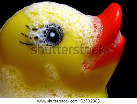 Rubber Ducky with Suds Closeup - stock photo