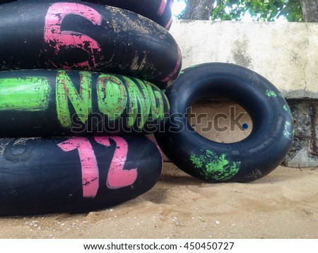 rubber on the beach in thailand - stock photo