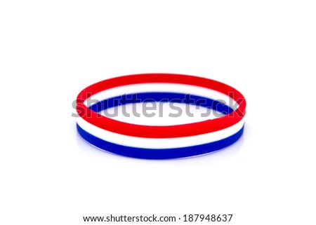 rubber plastic stretch thai flag bracelet isolated on white background. - stock photo