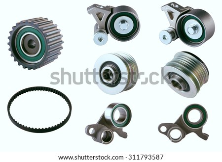 Rubber PV, gear belts and rollers for the car engine on a white background. The most popular parts of the car. Spare parts for shop, aftermarket, OEM. Isolated Engine Timing spare parts. - stock photo