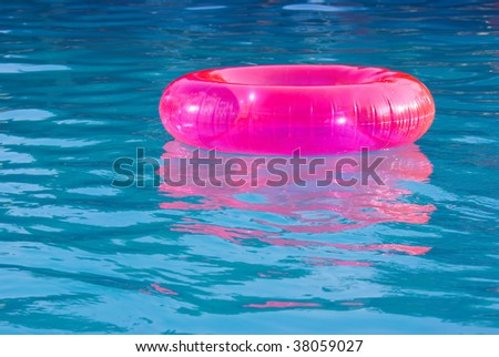 rubber ring in the swimming pool sunny day - stock photo