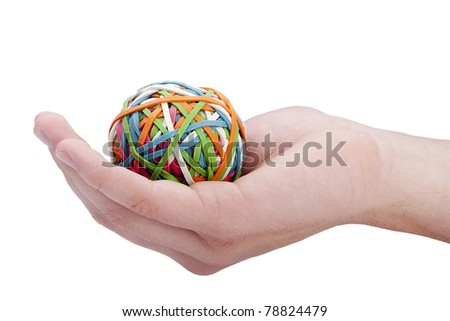 Rubber rings of different colors assembled for easy storage in a ball in a man's hand. - stock photo