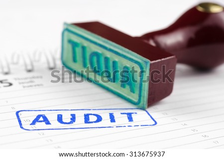 Rubber stamp with text audit and wooden handle - stock photo