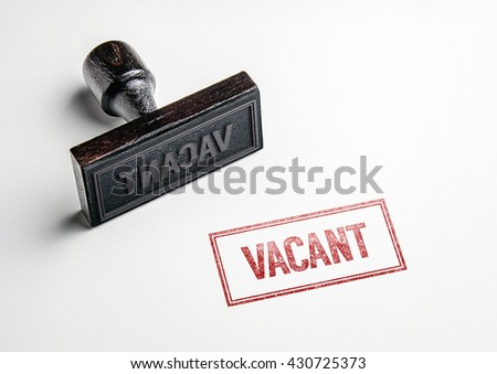 Rubber stamping that says 'Vacant'. - stock photo