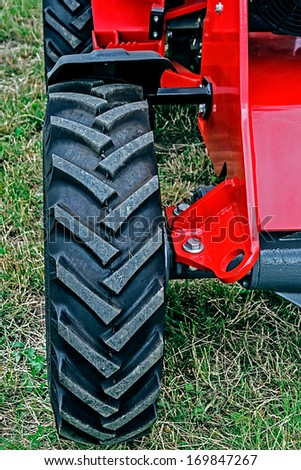 Rubber texture from front wheel of one tractor. - stock photo