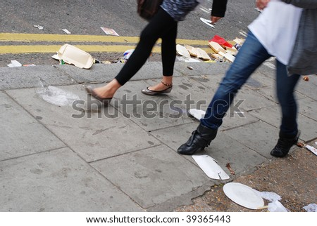 rubbish and passerby - stock photo