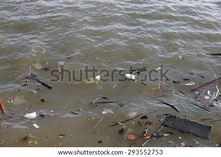 Rubbish are floating on river - stock photo