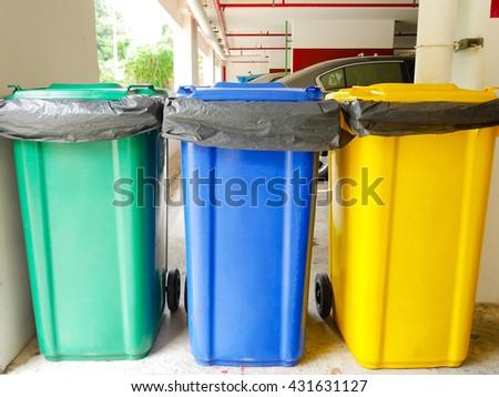 Rubbish bins in car park - stock photo
