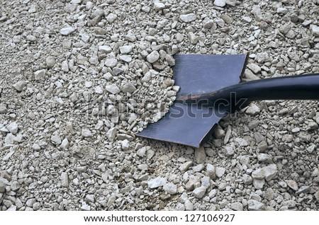 rubble and a black shovel - stock photo