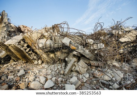 Rubble and scrap remaining after the demolition of the building - stock photo