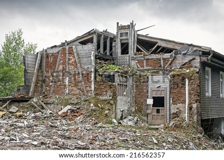 Rubble with demolished building - stock photo