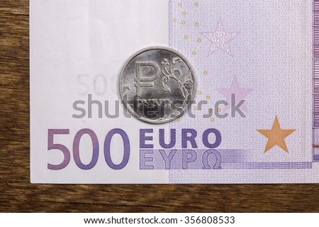 ruble coin and a Euro banknote close up - stock photo