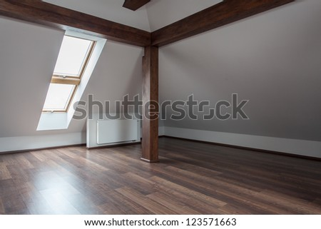 Ruby house - Empty loft with wooden floor and pillar, removal - stock photo