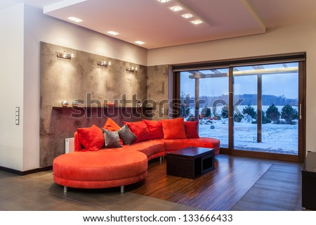 Ruby house - Huge, red and comfortable sofa - stock photo