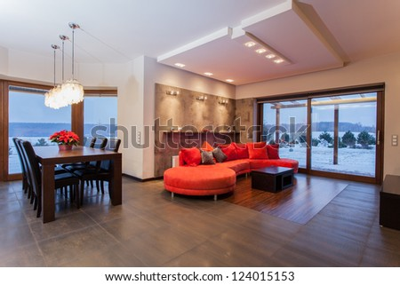Ruby house - Spacious living room with ruby sofa - stock photo