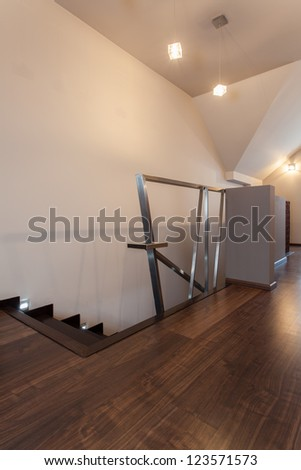 Ruby house - Stairs with original metal banister, modern interior - stock photo