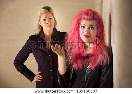 Rude child with frustrated parent in background - stock photo