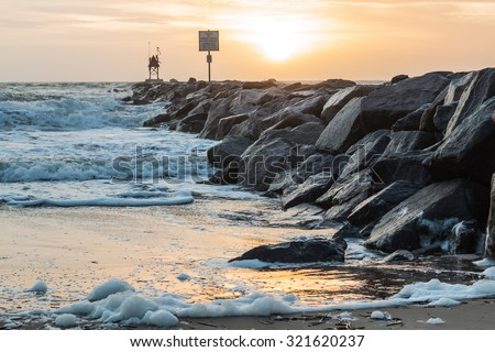 Rudee Inlet Rock Jetty at Dawn at the Virginia Beach Oceanfront - stock photo